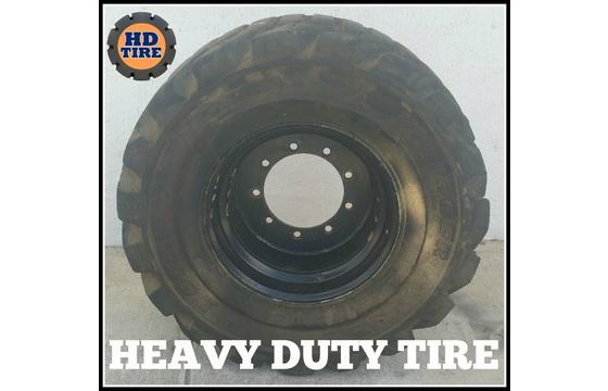 (1) 33x15.50-16.5 Used Foam Filled Tire On 9 Hole Wheel, 33-15.50x16.5 Tyre